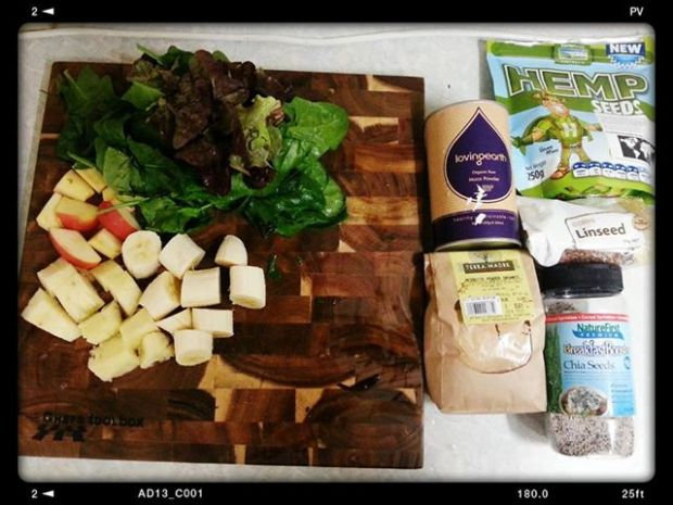 A green smoothie in the making.