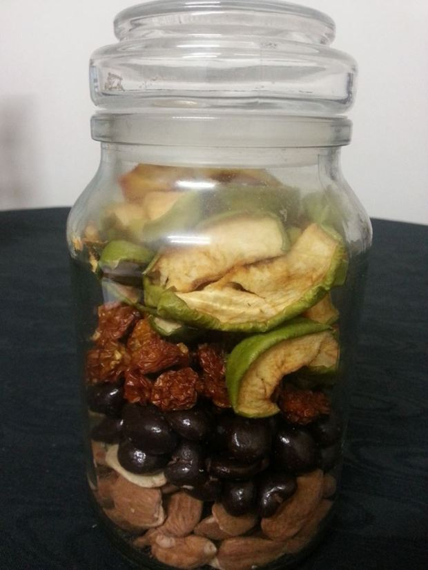 Dried apple, inca berries, chocolate coated cranberries and activated almonds.