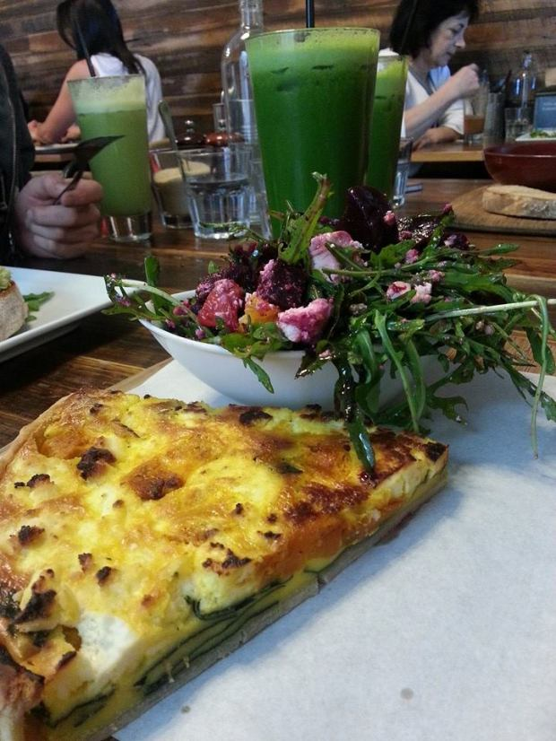 Quiche with beetroot and rocket salad, and a green juice.